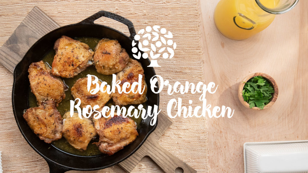 image of baked orange rosemary chicken in a cast iron skillet