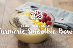 florida orange juice smoothie bowl topped with mango, berries, coconut and chia seeds