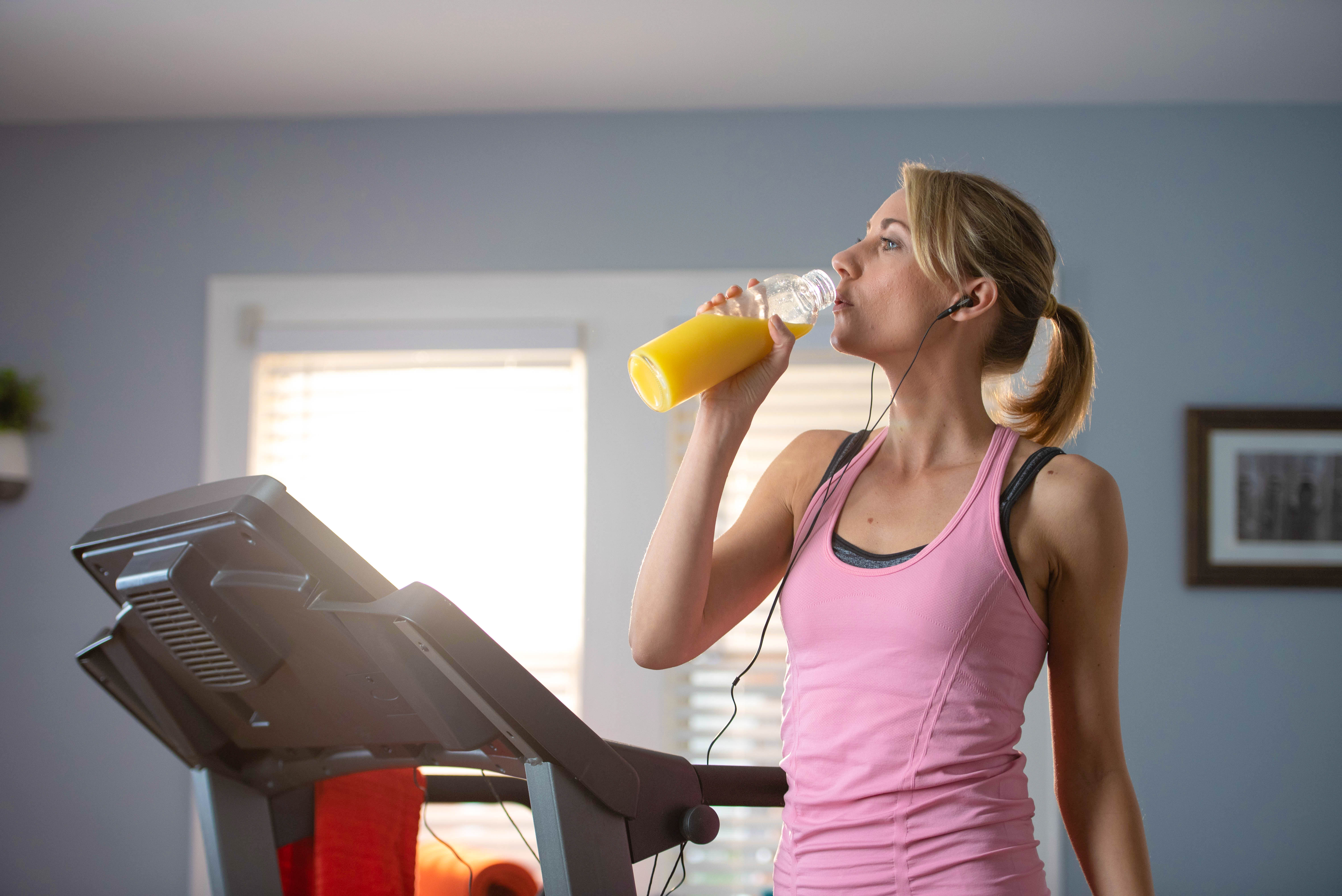 Woman Drinking Orange Juice Image