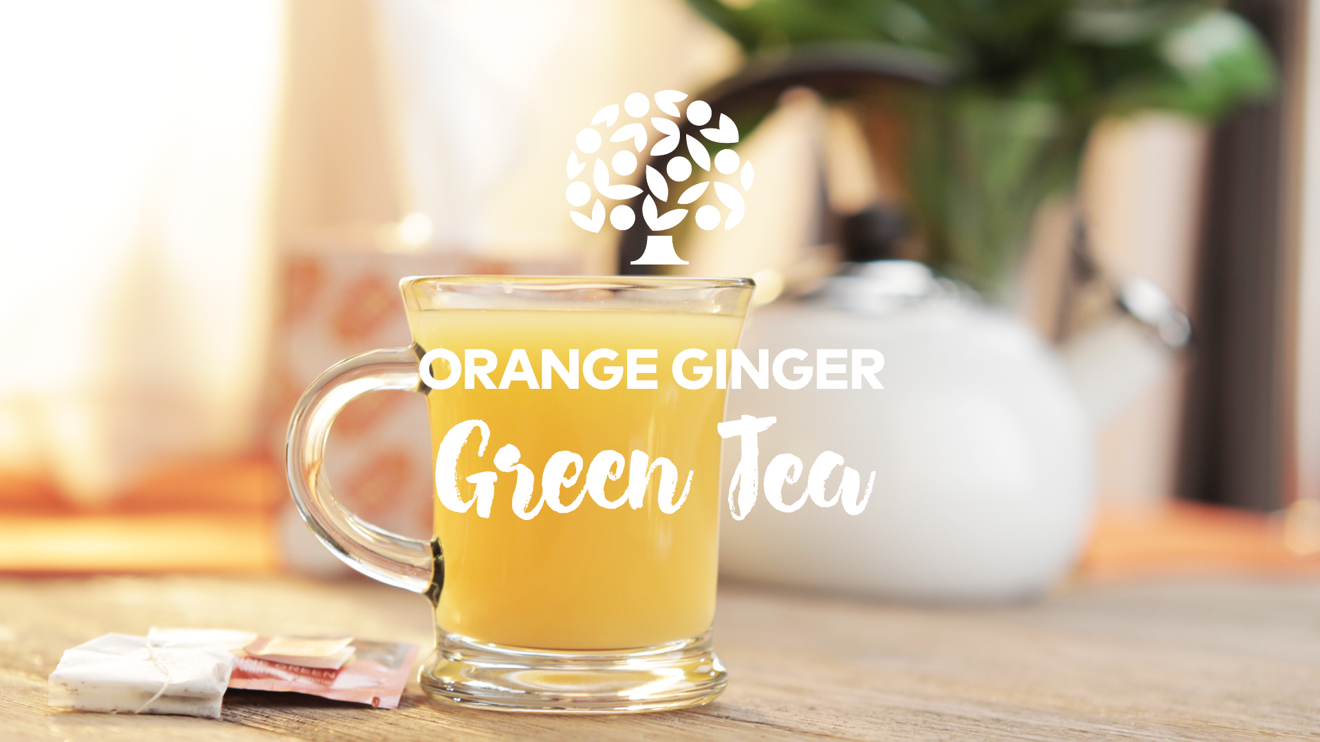 orange ginger green tea in a clear glass mug on a table