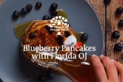 florida orange juice maple syrup being poured over blueberry pancakes